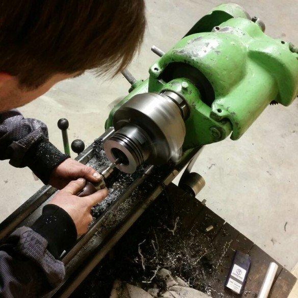 Jesse making prototype pistons.